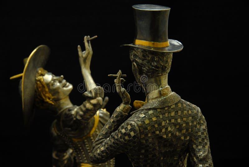 Figurine - Smoking woman. With a man stock image