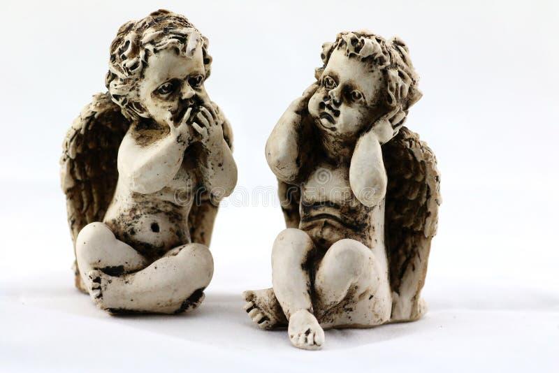 2 figurines ангела стоковые изображения rf