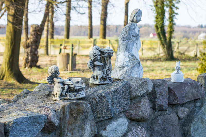 Figurines of angels. Standing on the stone wall royalty free stock images