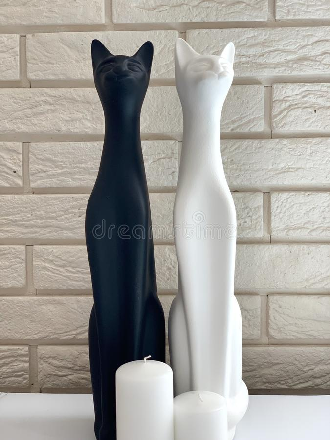 Figurines of cats white and black. royalty free stock photography
