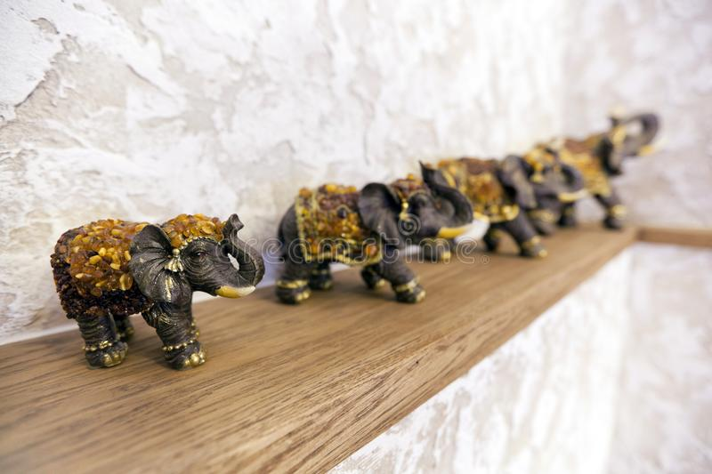 Figurines of elephants on the shelf luck, happiness in the house stock images