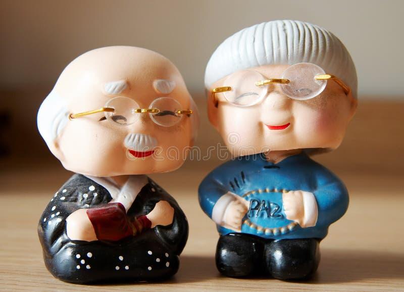 figurines för tecknad filmlerapar royaltyfria bilder