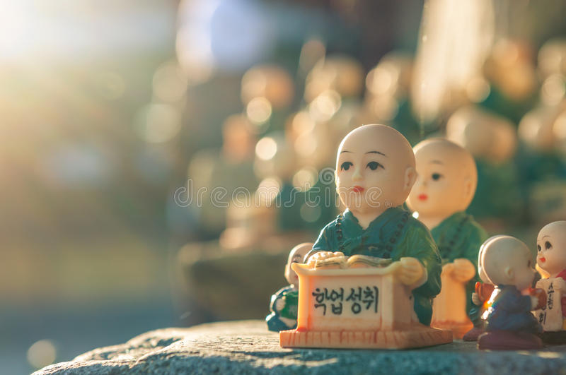 Figurines at Haedong Yonggungsa. Little figurines scattered around the rocks of Haedong Yonggungsa Temple in Busan, South Korea. The figurines are meant to stock photography
