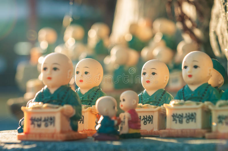 Figurines at Haedong Yonggungsa. Little figurines scattered around the rocks of Haedong Yonggungsa Temple in Busan, South Korea. The figurines are meant to royalty free stock photo