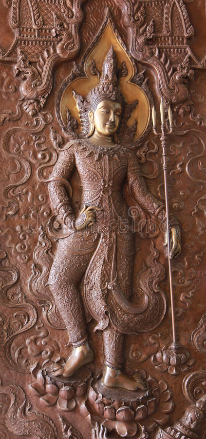 Figurines of Indra with vajra royalty free stock image