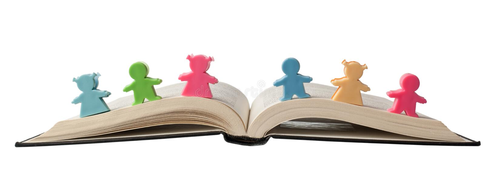 Download Figurines on open book stock photo. Image of literacy - 25590356