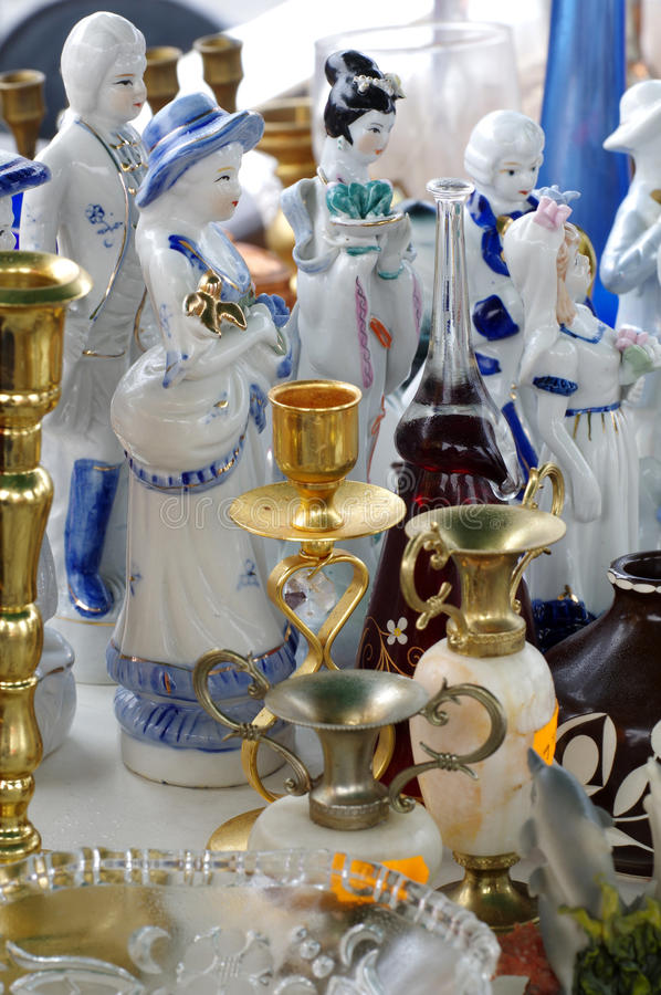 Figurines porcelain decorative objects flea market. Objects stock image