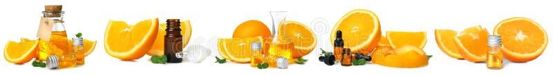Fije con aceite esencial anaranjado en el fondo blanco imágenes de archivo libres de regalías