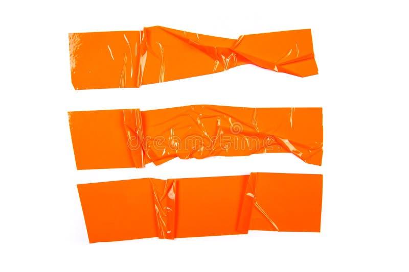 Fije de cintas anaranjadas en el fondo blanco imagen de archivo
