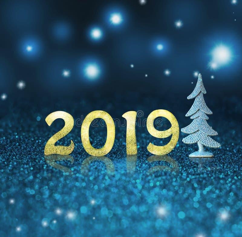 Fije de dígitos brillantes del oro en fondo del brillo Fondo 2018 del Año Nuevo Navidad fotografía de archivo libre de regalías