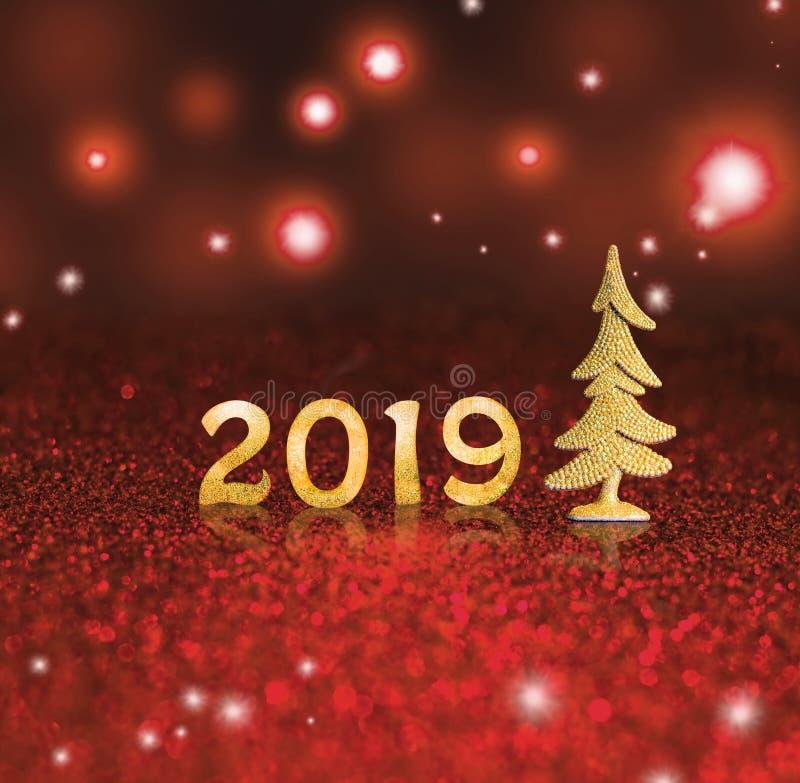 Fije de dígitos brillantes del oro en fondo del brillo Fondo 2018 del Año Nuevo Navidad imágenes de archivo libres de regalías