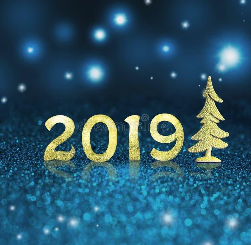 Fije de dígitos brillantes del oro en fondo del brillo Fondo 2018 del Año Nuevo Navidad imagen de archivo