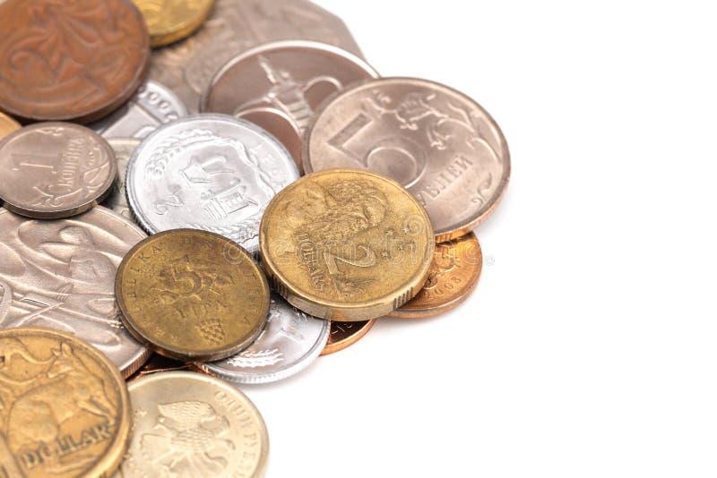 Fije de diversas monedas de todo el mundo foto de archivo