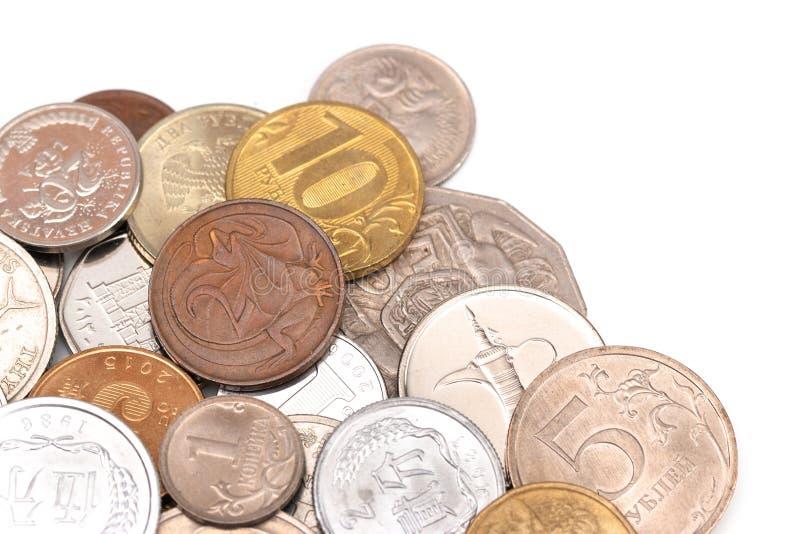 Fije de diversas monedas de todo el mundo fotos de archivo libres de regalías