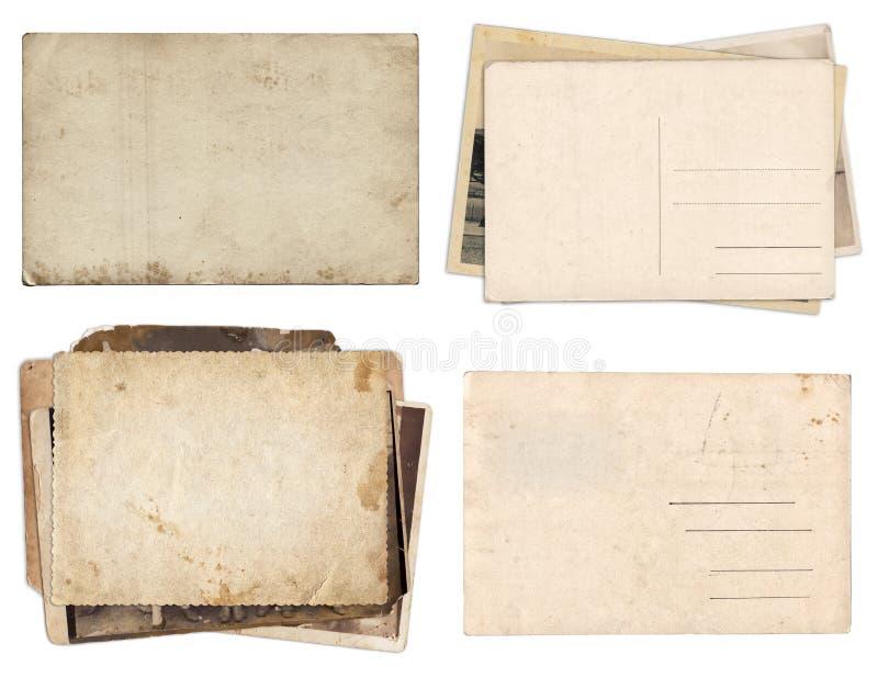Fije de diversos papeles viejos y las postales con los rasguños y las manchas texturizan aislado imagen de archivo libre de regalías