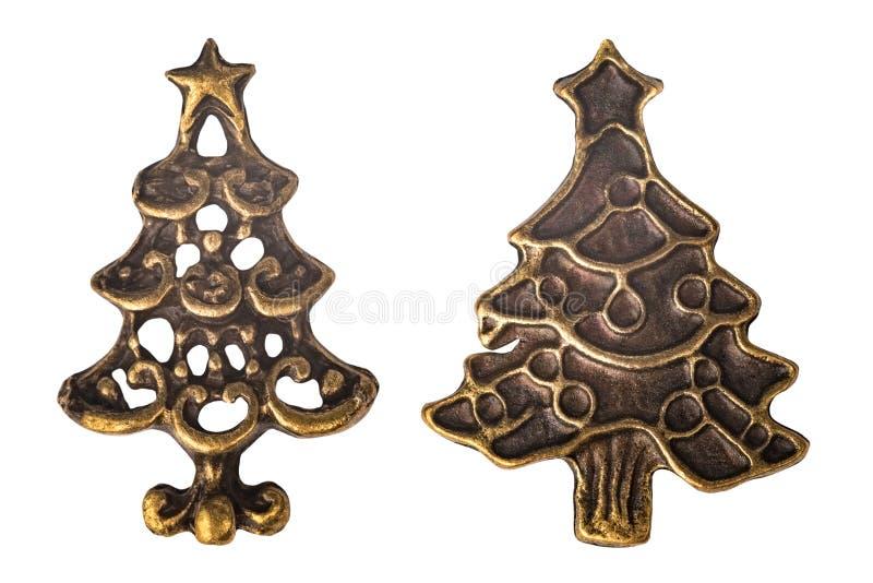 Fije de dos árboles de navidad de latón del metal del vintage aislados en el fondo blanco imagenes de archivo