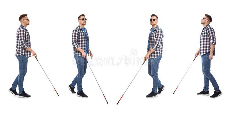 Fije de hombre ciego con caminar largo del bastón fotos de archivo