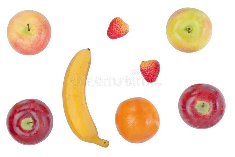 fije de las frutas artificiales aisladas en el fondo blanco foto de archivo
