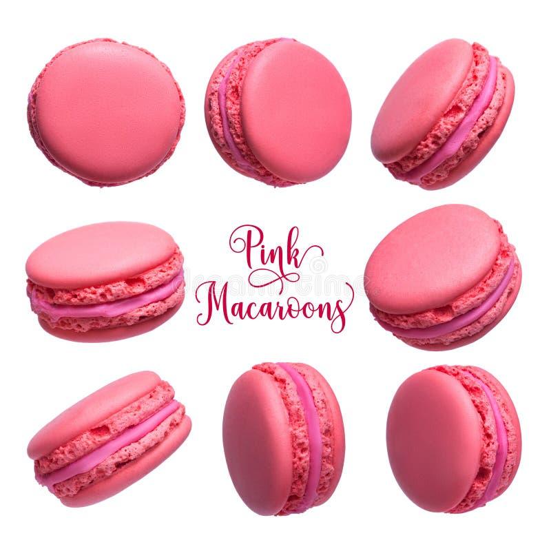 Fije de las tortas francesas rosadas de los macarons aisladas en el fondo blanco imagenes de archivo