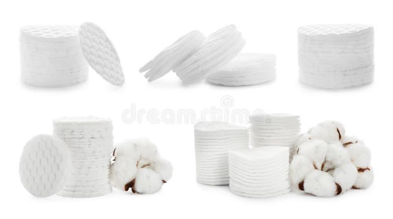 Fije de los cojines y de las flores apilados de algodón en blanco fotografía de archivo