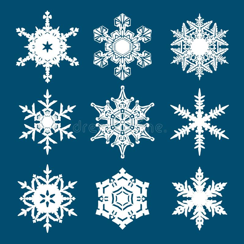 Fije de los copos de nieve blancos aislados en fondo azul Vector libre illustration