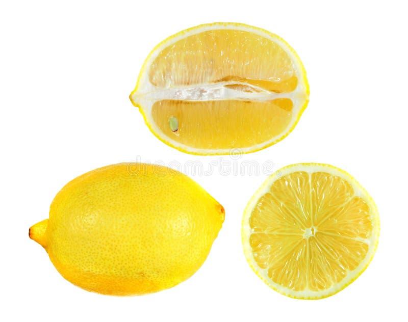 Fije de medio corte y del limón entero aislados en el fondo blanco imagen de archivo libre de regalías