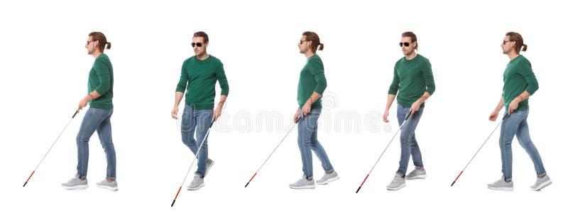 Fije del hombre ciego joven con el bastón largo que camina en blanco foto de archivo libre de regalías