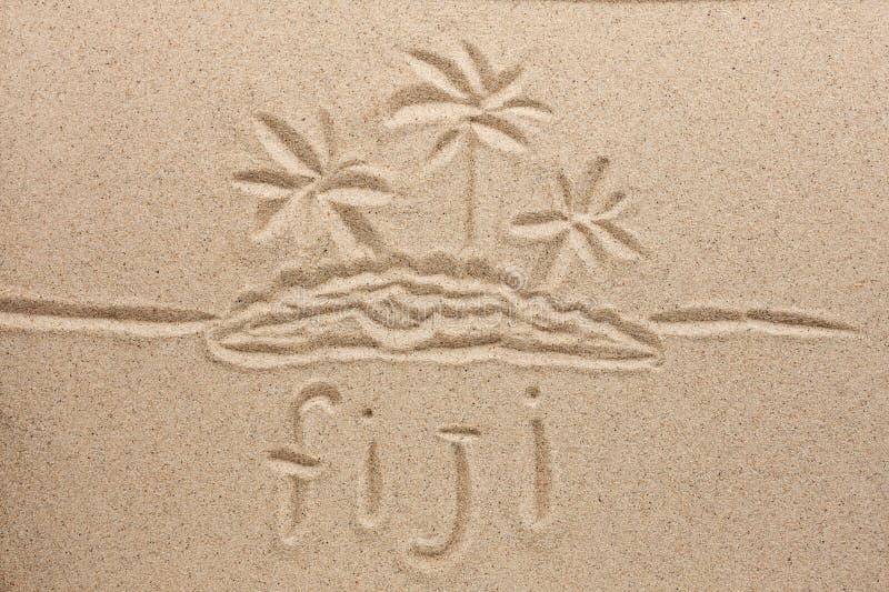 Fiji ręcznie pisany w piasku dla naturalnego, symbol zdjęcie stock