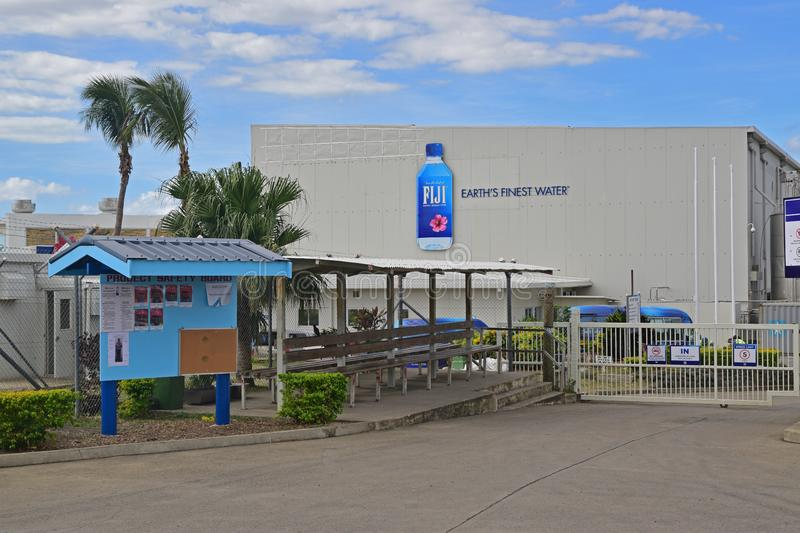 Fiji Water bottled water factory at the north of Viti Levu, Fiji with blue project safety board. The water is sourced from Yaqara, bottled and eventually shipped royalty free stock photography