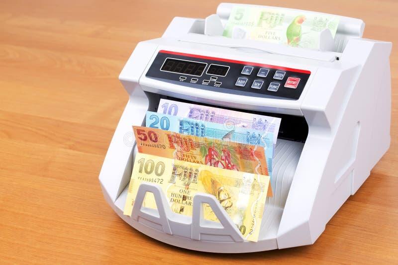 Fijian dollar i en räknande maskin royaltyfri bild