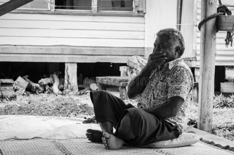 Fijian man laughing and covering his mouth stock photo