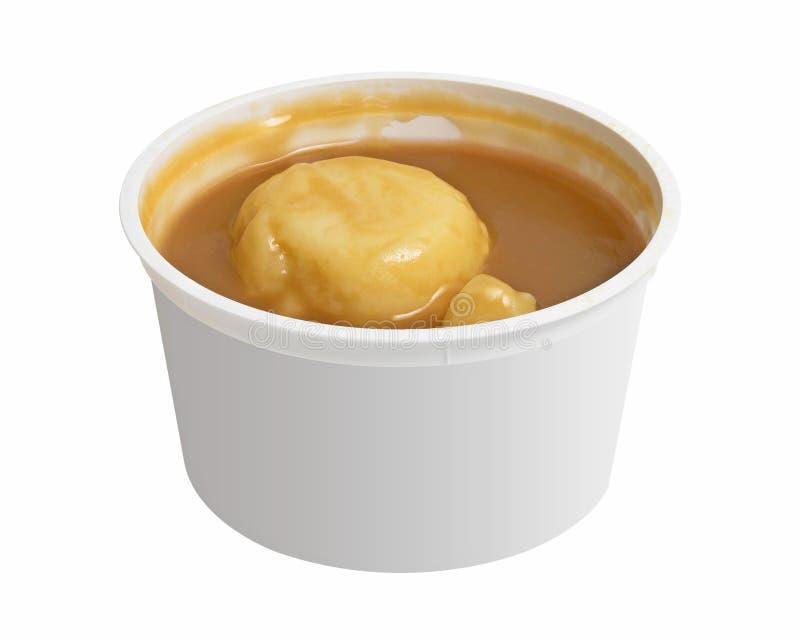 Fijngestampte die aardappels in een kom op witte achtergrond wordt geïsoleerd Kop van vlotte aardappelpuree Knippende weg royalty-vrije stock afbeeldingen