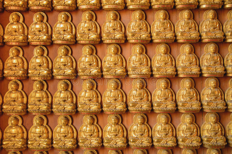 Fila Buddha piccolo immagine stock