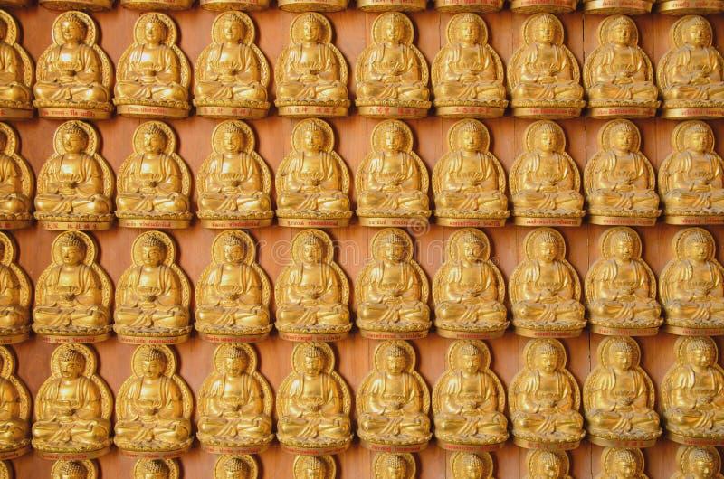 Fila Buddha piccolo fotografia stock libera da diritti