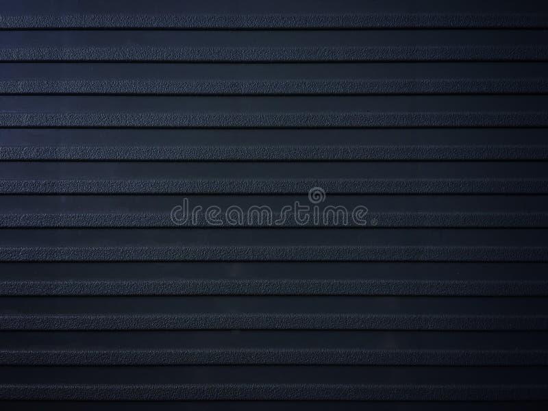 Fila de la superficie áspera en el fondo negro de la decoración del asiento imagen de archivo