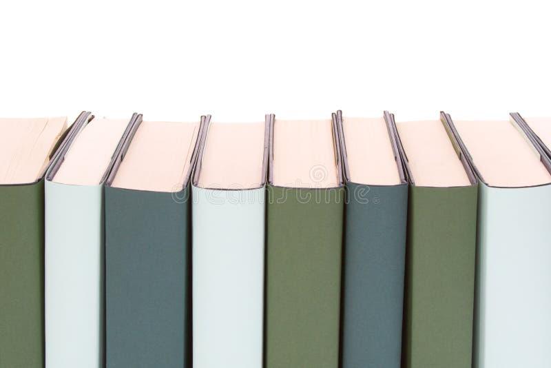 Fila de libros fotos de archivo