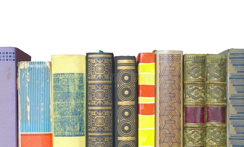 Fila de libros, aislada fotos de archivo