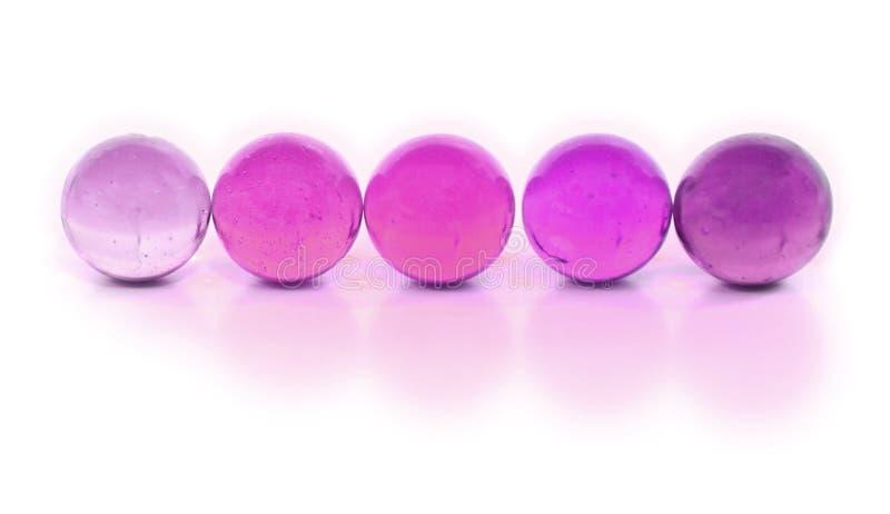 Fila de mármoles coloridos foto de archivo