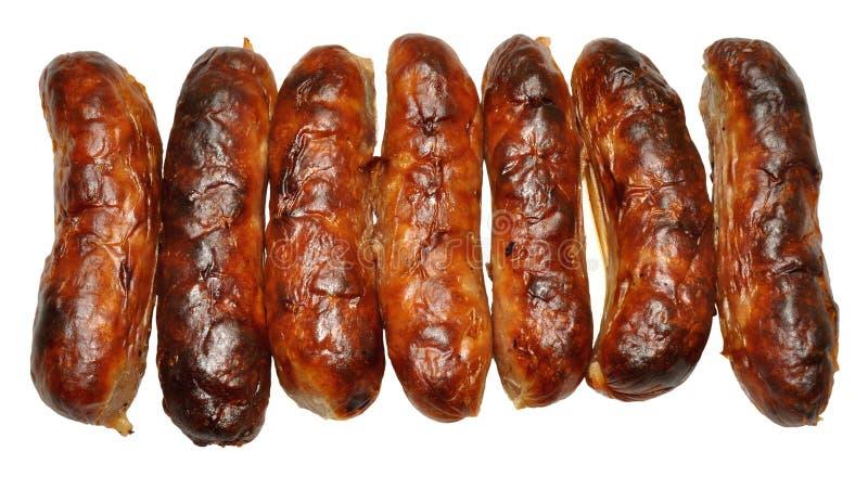 Fila de salchichas cocinadas imagen de archivo