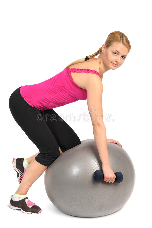 Fila della testa di legno del Un-braccio sull'esercizio della palla di forma fisica di stabilità fotografia stock