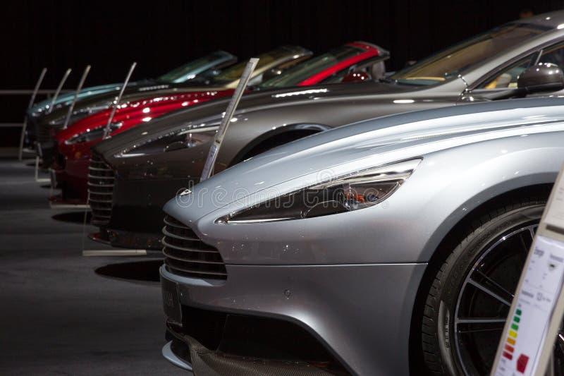 Fila di Aston Martins immagine stock