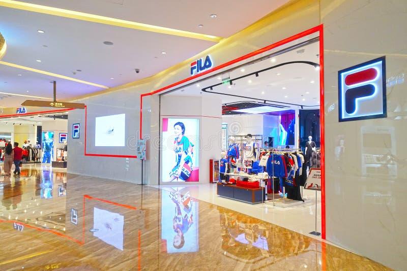 Fila logo sports retail shop front shopping mall. Fila fashion shop with logo and sign. fila sports retail store front in shopping mall China royalty free stock photo