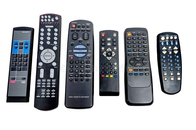 Fila larga de mandos a distancia usados sucios imagen de archivo libre de regalías