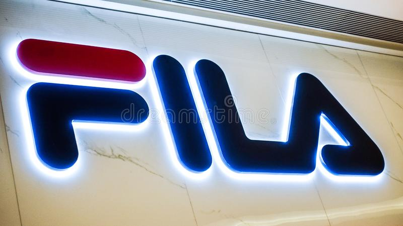 Fila logo. Fila fashion shop with logo and sign. fila sports retail store front in shopping mall royalty free stock photo