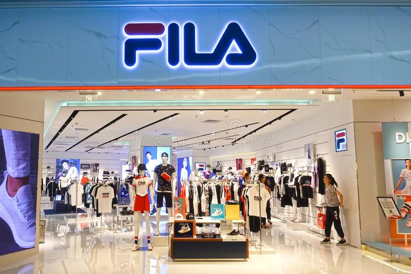 Fila logo sports retail shop front. Fila fashion shop with logo and sign. fila sports retail store front in shopping mall China stock images