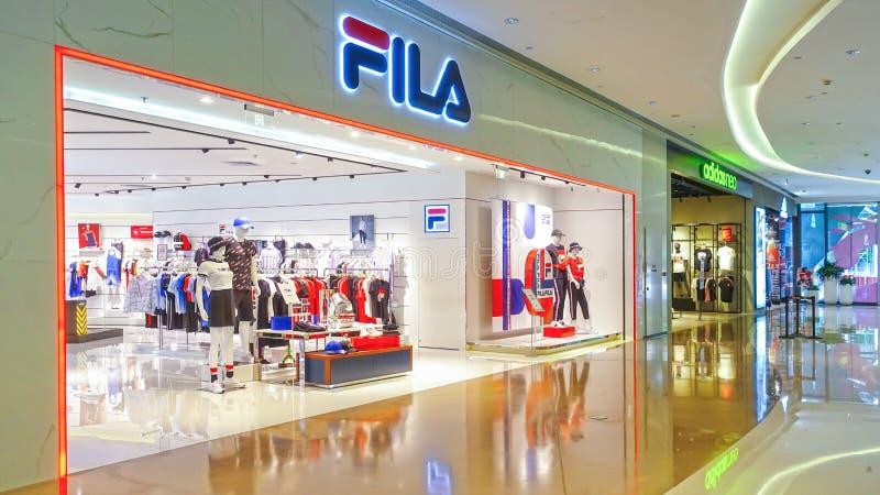 Fila logo sports retail shop front shopping mall. Fila fashion shop with logo and sign. fila sports retail store front in shopping mall China stock photos