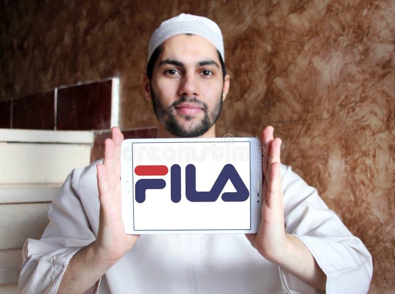 Fila logo. Logo of fila sportswear company on samsung tablet holded by arab muslim man royalty free stock images