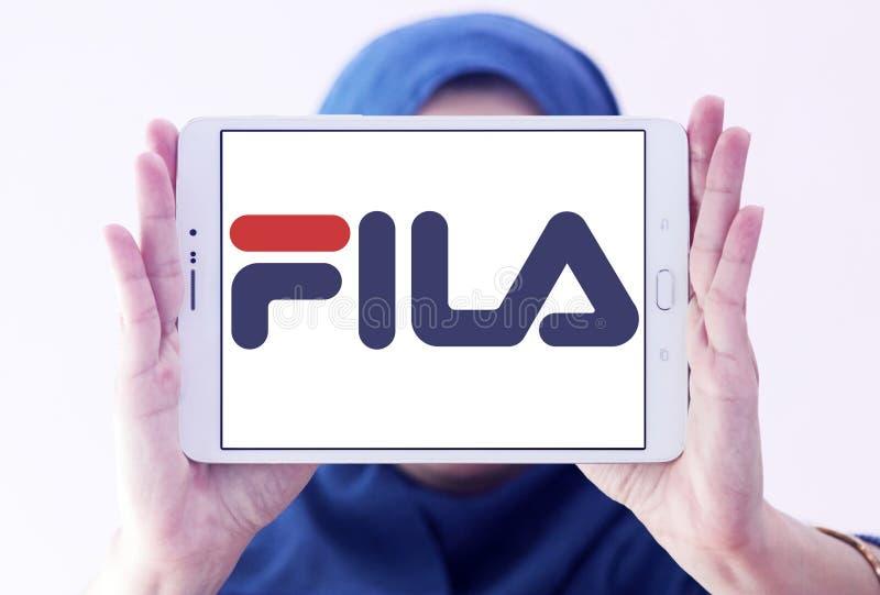 Fila logo. Logo of fila sportswear company on samsung tablet holded by arab muslim woman royalty free stock images