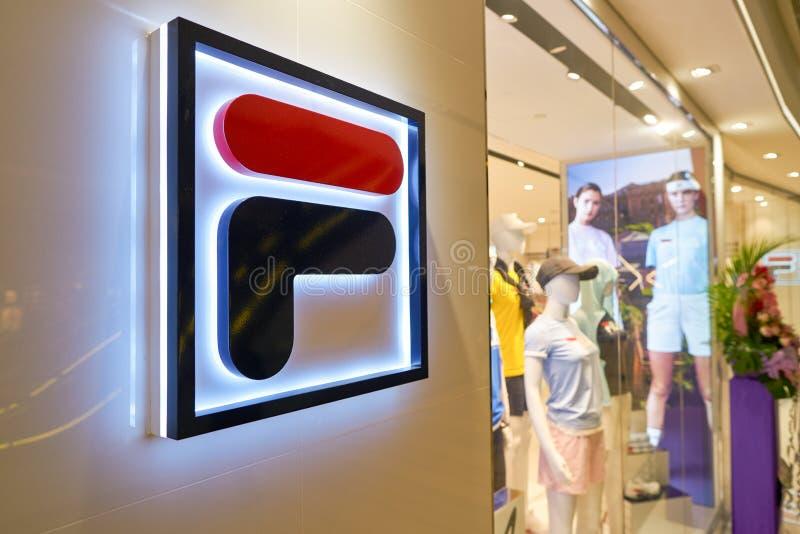 Fila. SINGAPORE - CIRCA APRIL, 2019: close up shot of Fila sign at a store in Jewel Changi Airport stock photo