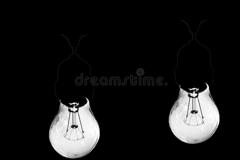 Filament bulbs on black stock image